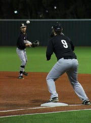 First baseman Ryan Taylor catches to ball to force an out at Hoskins Field Friday night as Rider defeated Old High 6-2.