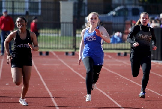 City View's Onjolyce Navarro, left, Graham's Claire Jones and Henrietta's Sadie Kabisch compete in the DII 100 meter dash at the PK Relay Saturday, March 16, 2019, in Graham.