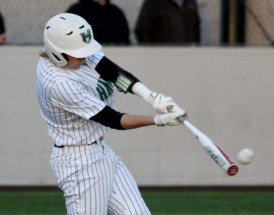 Iowa Park's Kase Johnson hits a double against Benbrook Friday, March 15, 2019, in Iowa Park.