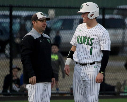 Iowa Park's Trent Green talks with head baseball coach Michael Swenson at third base in the game against Benbrook Friday, March 15, 2019, in Iowa Park.