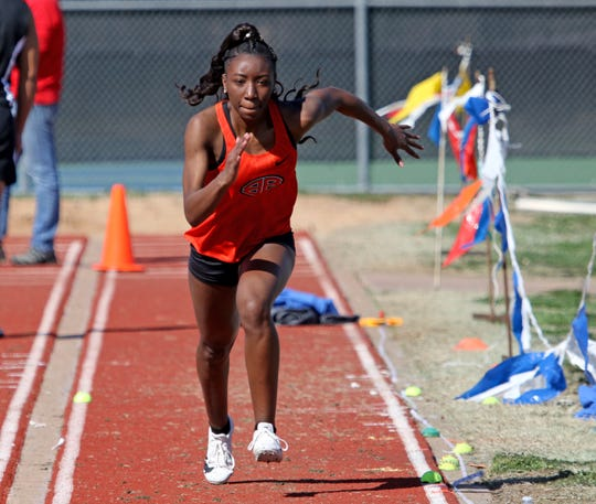 Burkburnett's Alashonte Massey competes in the long jump at the PK Relay Saturday, March 16, 2019, in Graham.