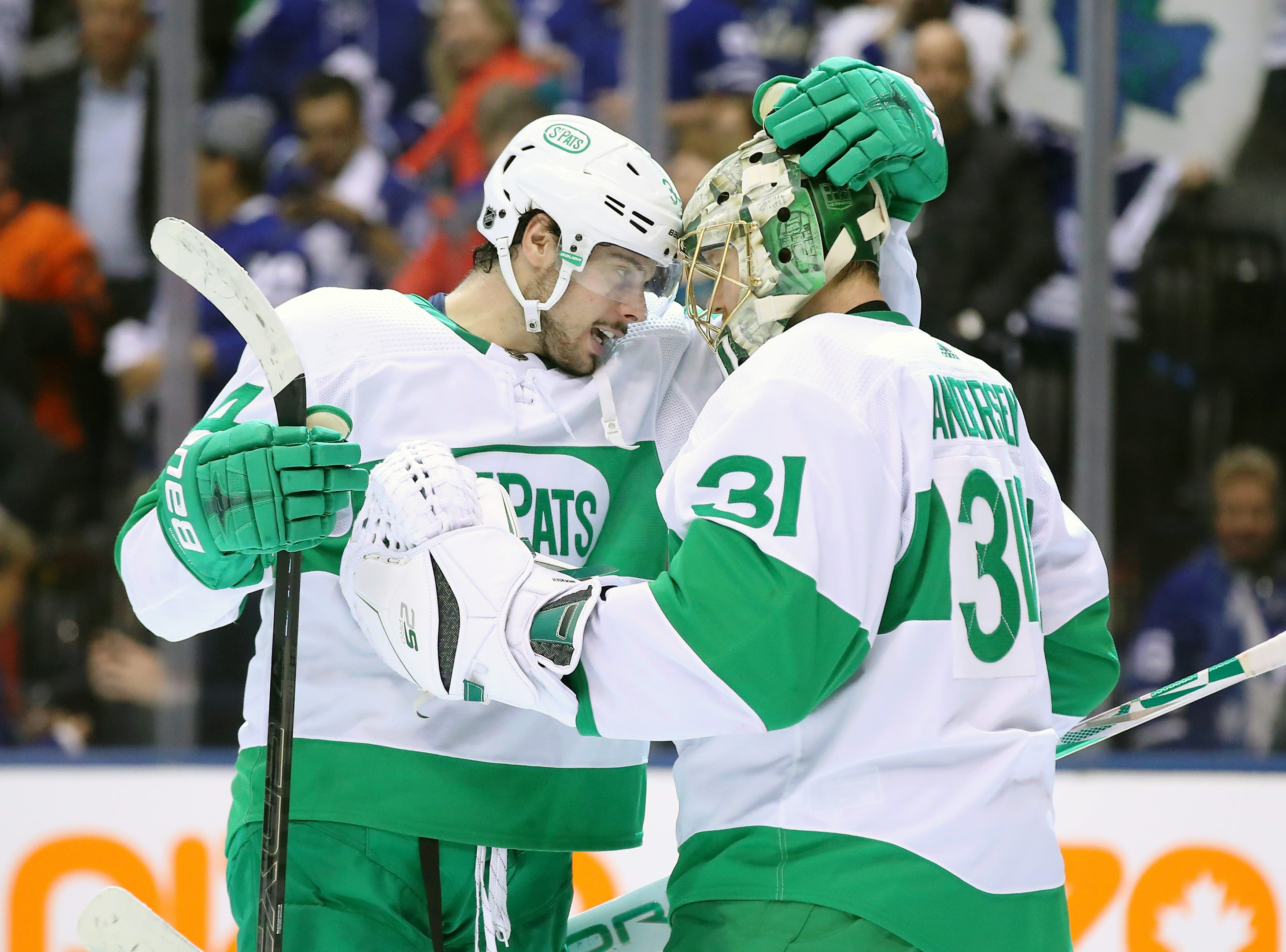 March 15: Toronto Maple Leafs center Auston Matthews, left, and goalie Frederik Andersen, wearing St. Pats jersey, celebrate their come-from-behind victory against the Philadelphia Flyers. Matthews scored twice in the game.