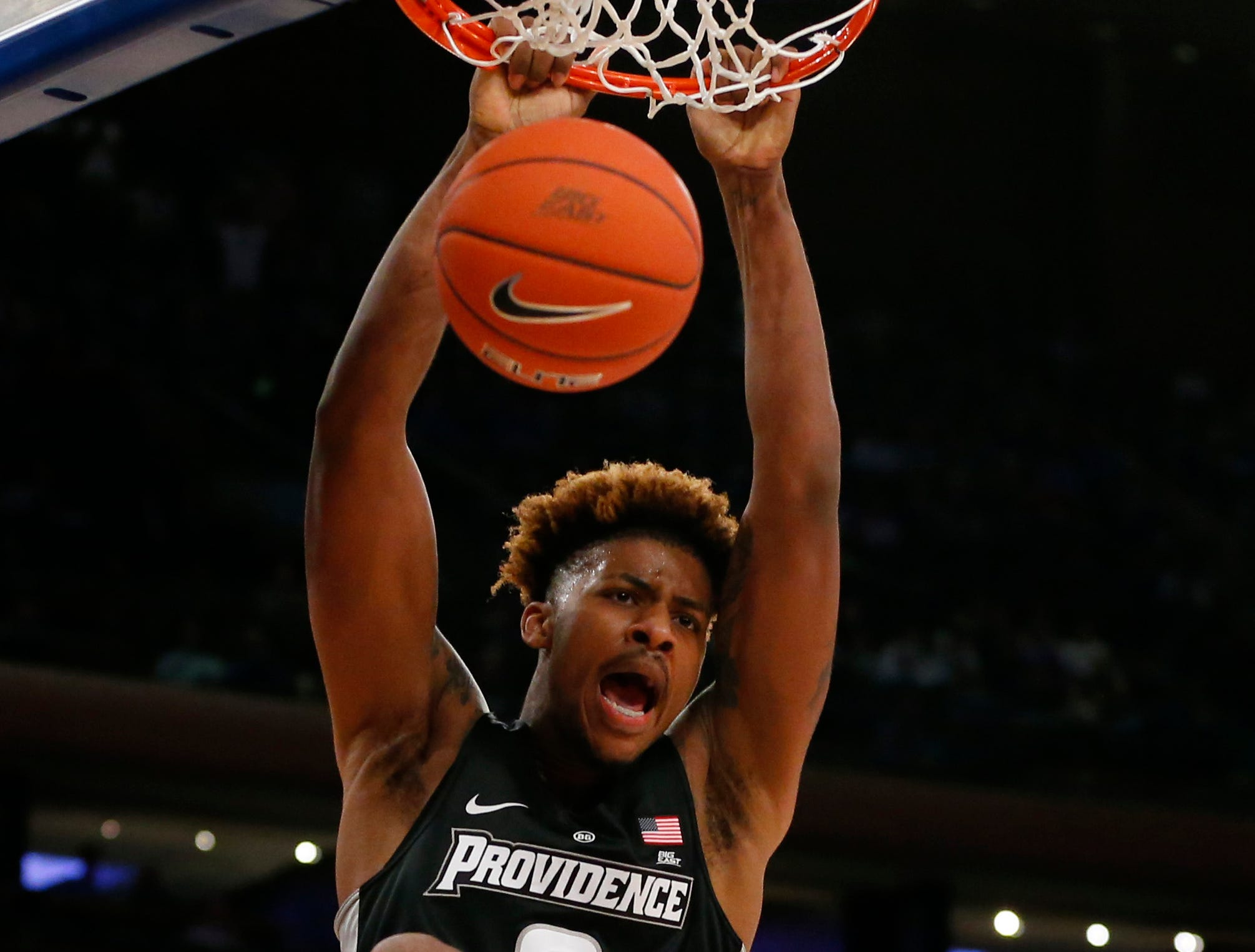 March 14: Providence Friars center Nate Watson (0) dunks against the Villanova Wildcats during the first half of a Big East tournament game.