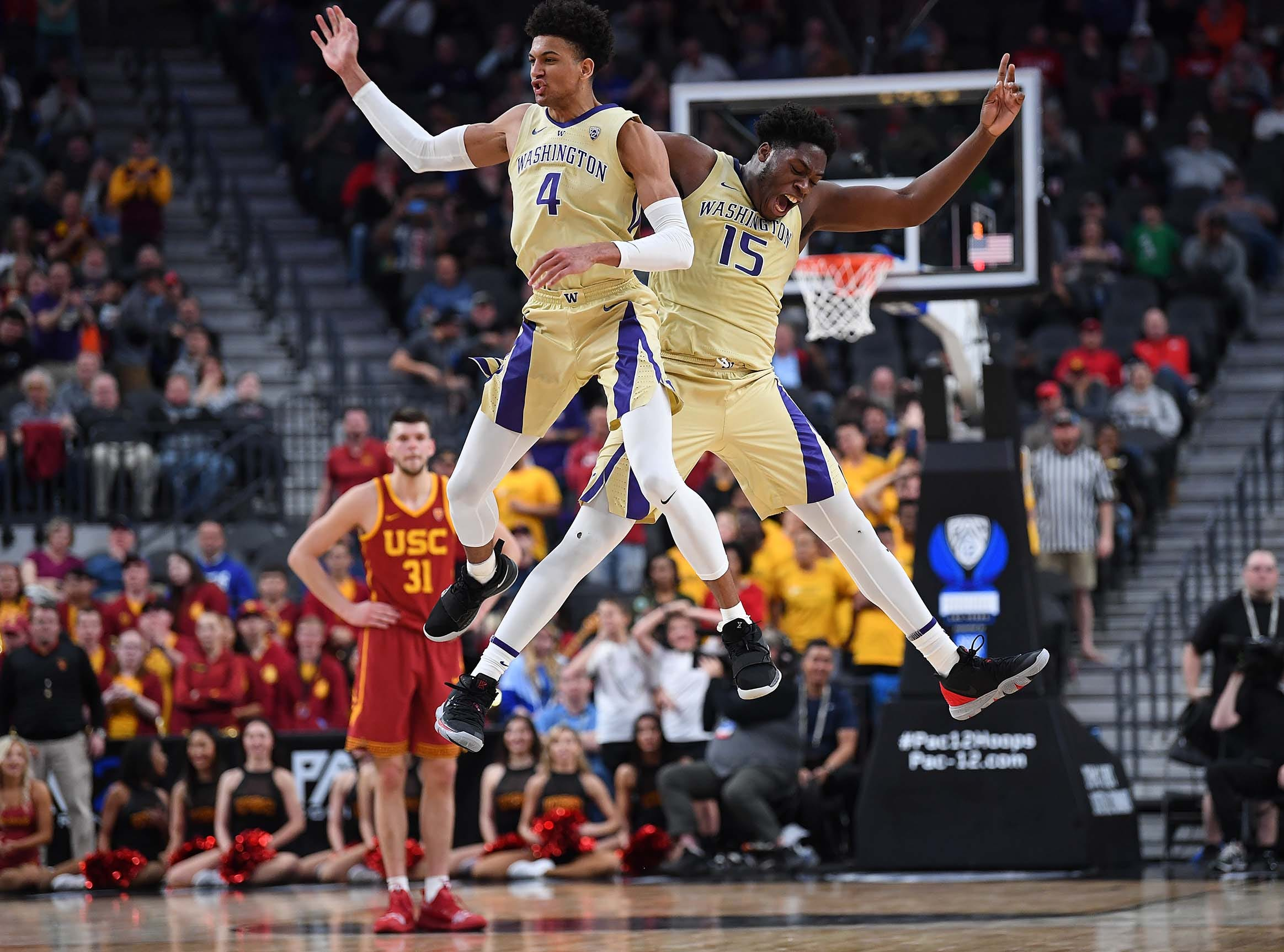 March 14: Washington Huskies guard Matisse Thybulle (4) celebrates with forward Noah Dickerson (15) in the final seconds of a Pac-12 conference tournament game against the USC Trojans.