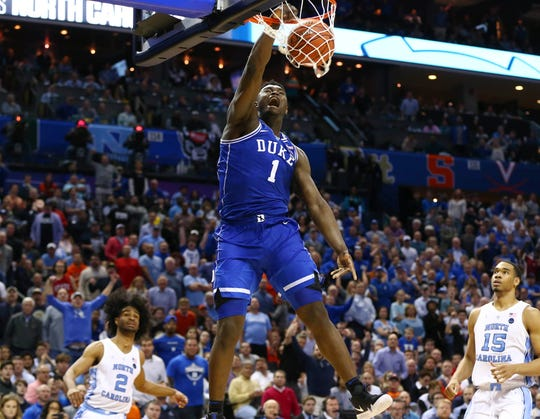 Zion Williamson slams home two of his game-high 31 points.