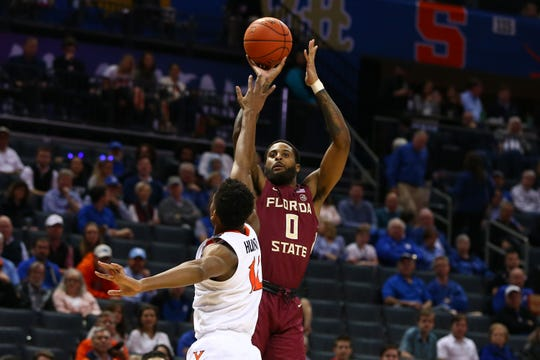 Florida State Seminoles forward Phil Cofer (0) shoots the ball against Virginia Cavaliers guard De'Andre Hunter (12) in the first half.