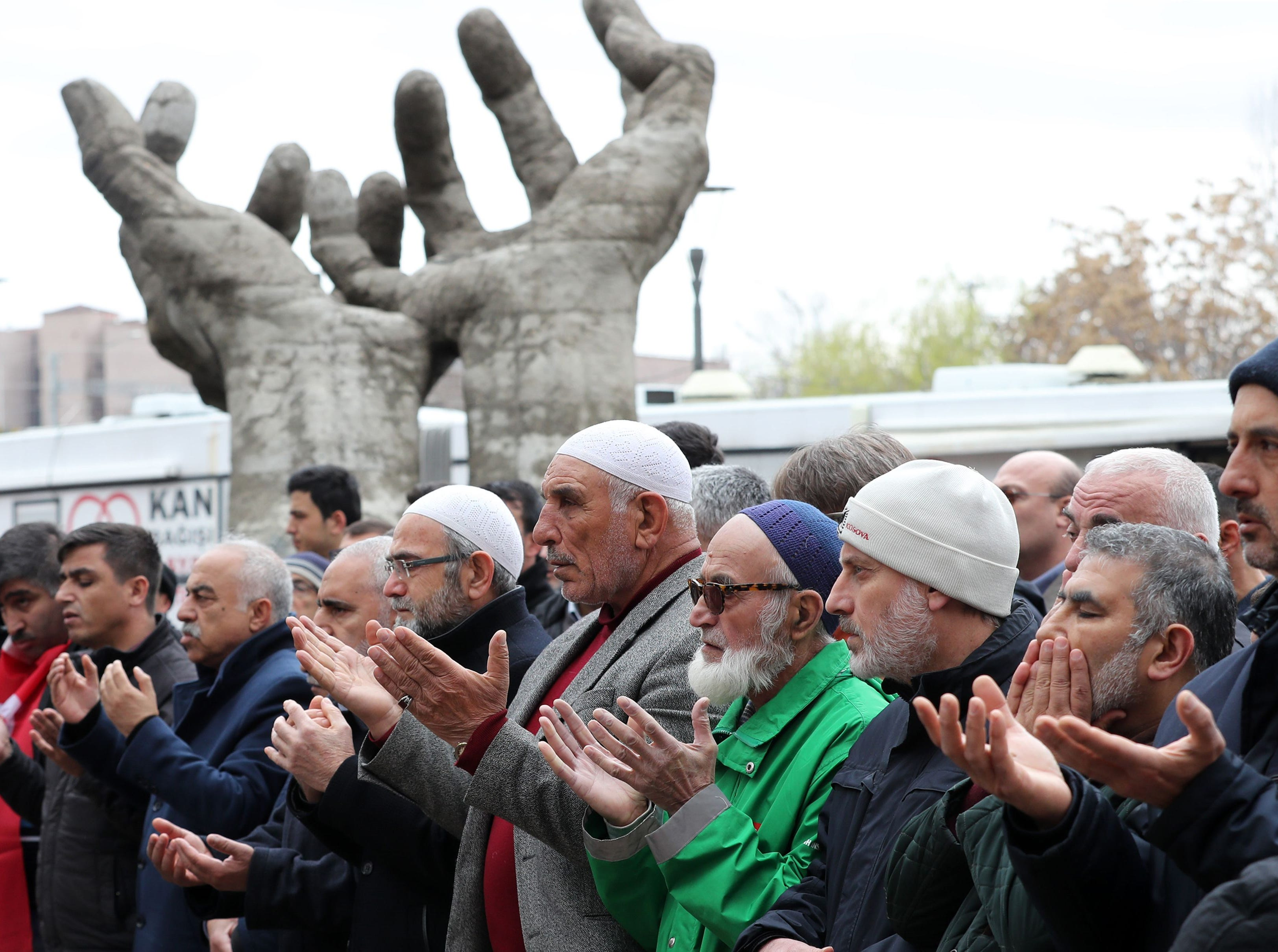 People perform a funeral prayer in absentia for those who lost their lives during twin terror attacks in New Zealand mosques, on March 16, 2019 in Ankara, Turkey.