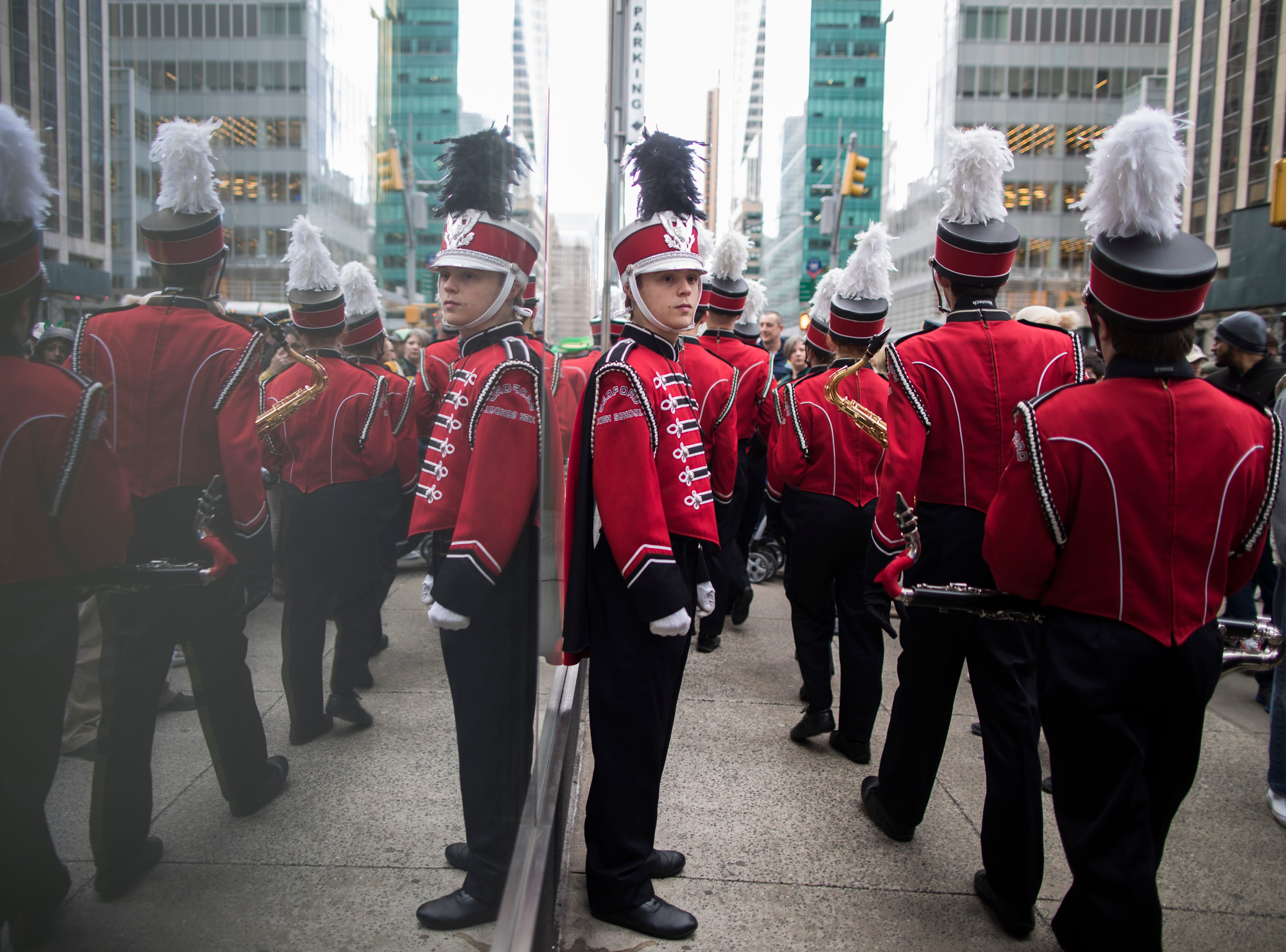 Members of a band line up before marching up Fifth Avenue during the St. Patrick's Day Parade, Saturday, March 16, 2019, in New York.