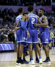 Duke's Zion Williamson, Cam Reddish and R.J. Barrett  huddle with teammates against the North Carolina Tar Heels in the ACC tournament.