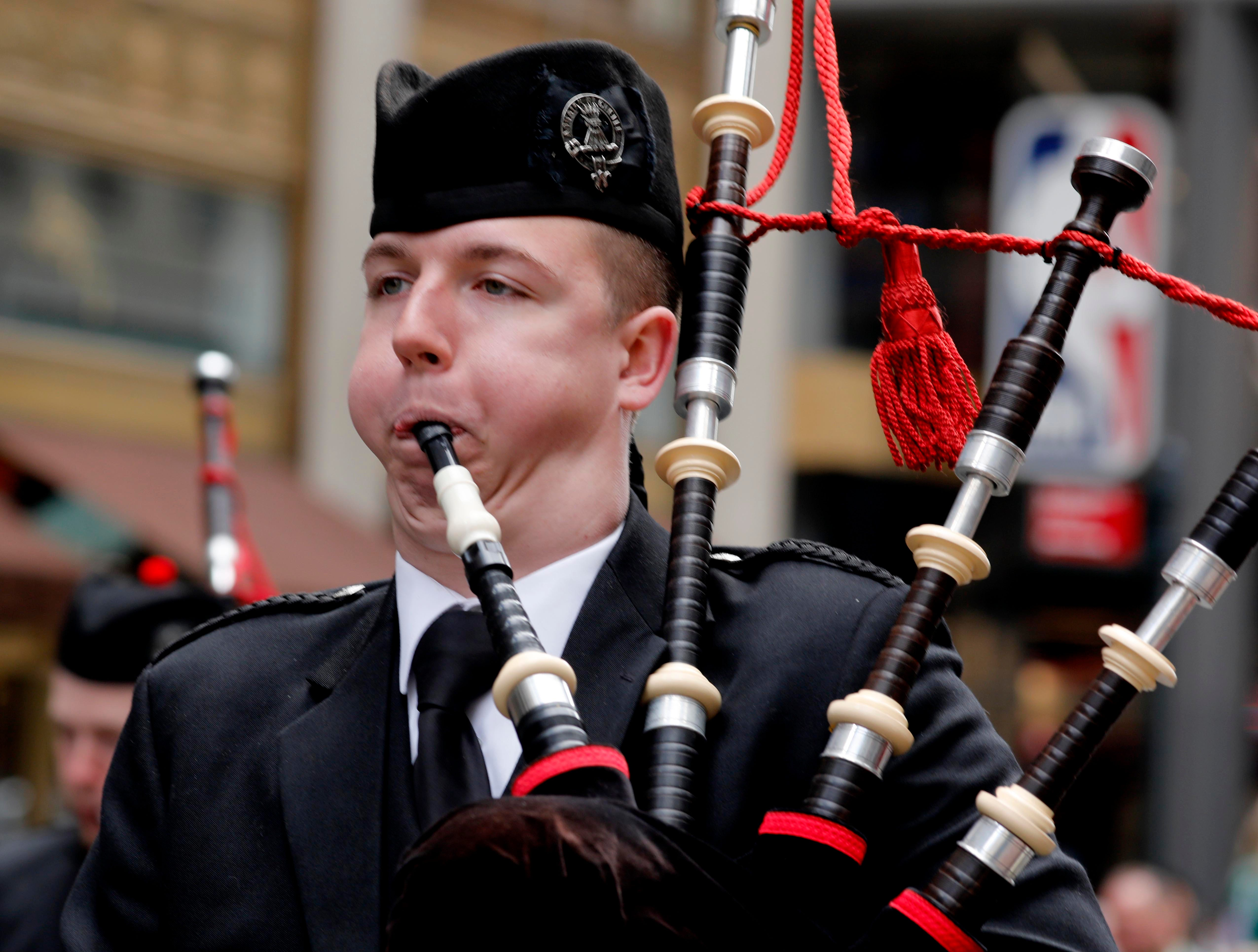 Aidan Alnwick, a bagpiper in the Iona College Pipe Band marches in the 258th annual St. Patrick's Day Parade on March 16, 2019. Hundreds of thousands of people lined Fifth Ave. as the parade made its way from 44th St. up to 79th St.