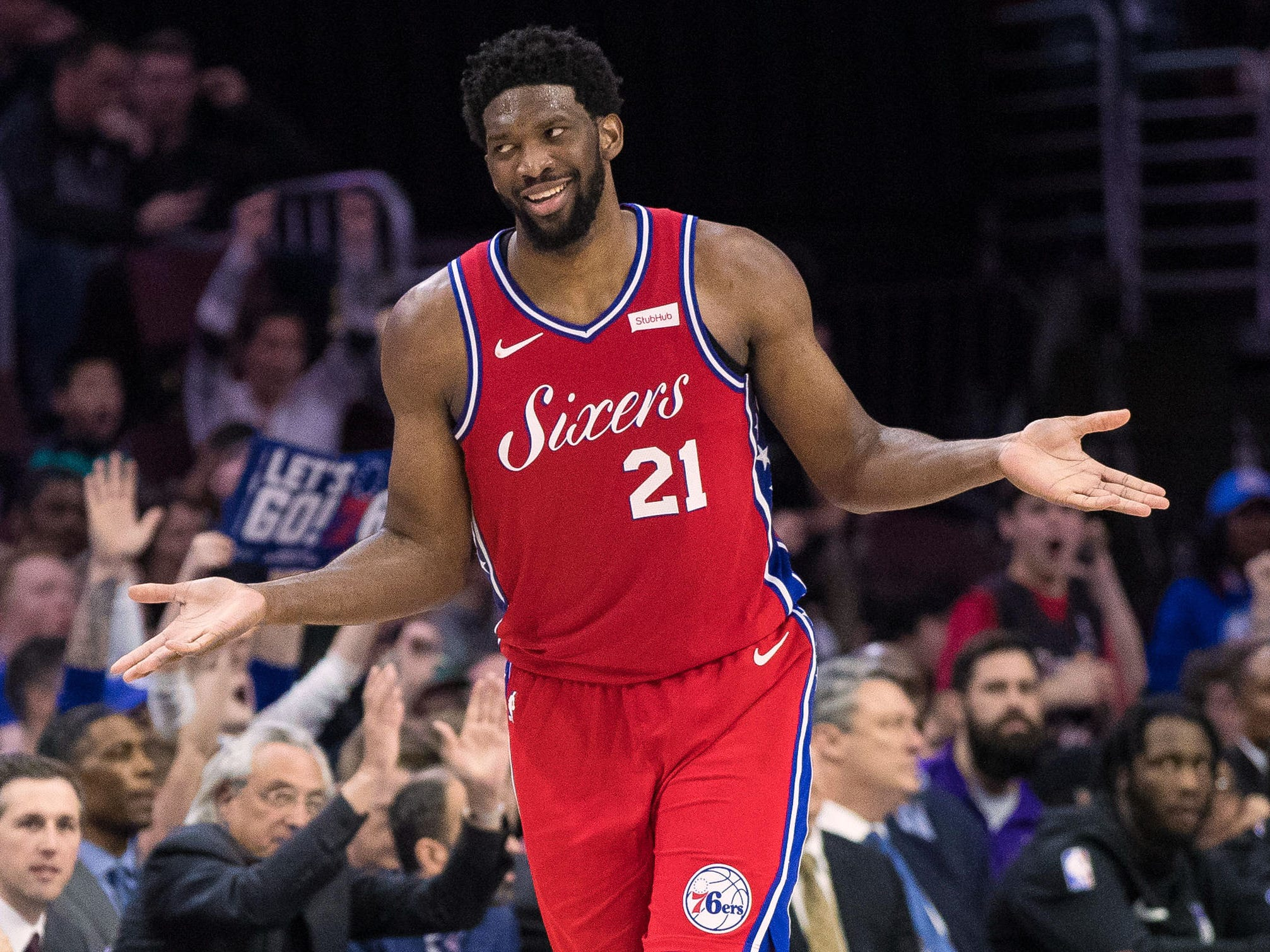 March 15: Sixers center Joel Embiid has a shrug and a smile for the fans after hitting a 3-pointer during a win over the Kings in Philadelphia.