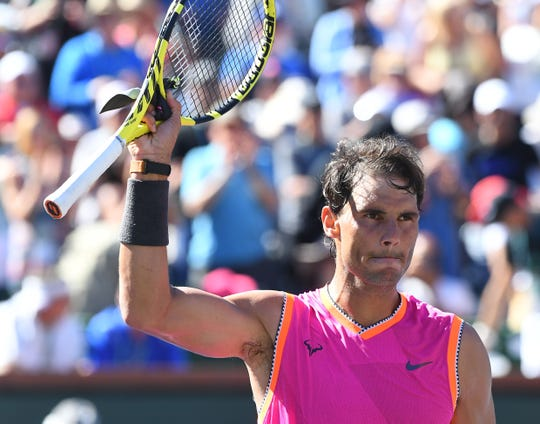 Rafael Nadal waves to the crowd after winning his third-round match against Diego Schwartzman.