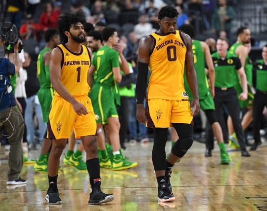 Arizona State Sun Devils guard Remy Martin (1) and guard Luguentz Dort (0) walk off the court after losing to the Oregon Ducks 79-75 in overtime of the Pac-12 conference tournament final at T-Mobile Arena.