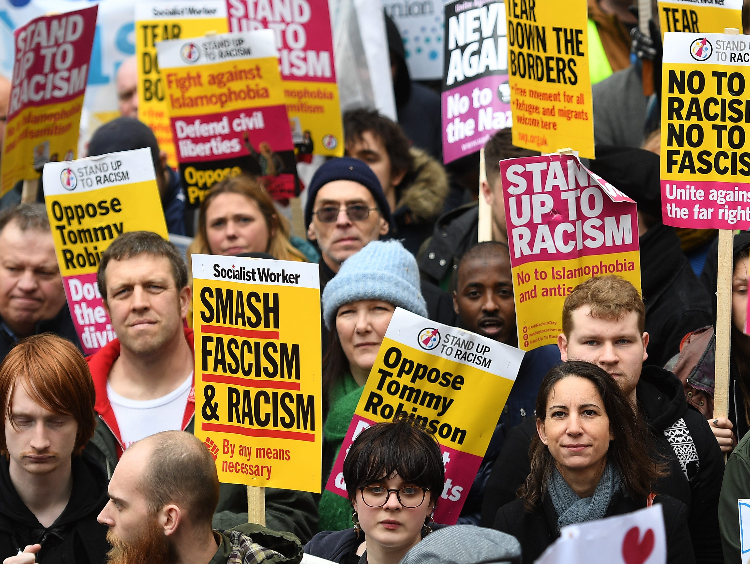 Anti racism protesters stand during a UN anti racism day march in London, Britain on March 16, 2019. Marches across the world took place during UN anti racism day condemning the attacks on muslims in New Zealand this week. At least 49 people were killed by a gunman, believed to be Brenton Harrison Tarrant, and 20 more injured and in critical condition during the terrorist attacks against two mosques in Christchurch, New Zealand during the Friday prayers on 15 March.