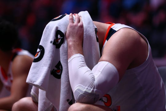 Virginia Cavaliers center Jack Salt (33) sits on the bench prior to a game against the Florida State Seminoles.