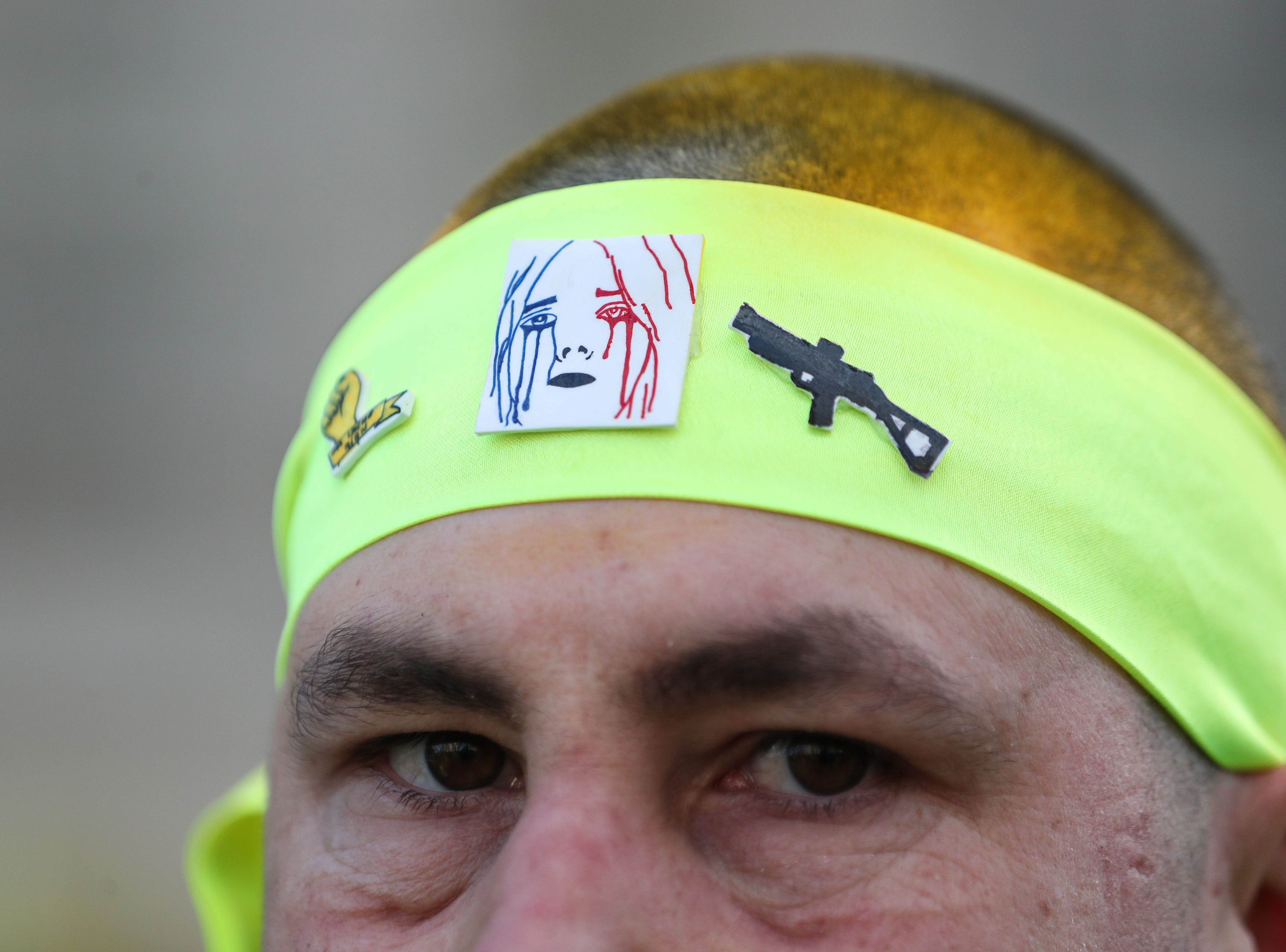 A Yellow Vest protester with yellow dyed hair wears a yellow headband, on the Champs-Elysees avenue in Paris on March 16, 2019, during clashes on the 18th consecutive Saturday of demonstrations called by the 'Yellow Vest' (gilets jaunes) movement.