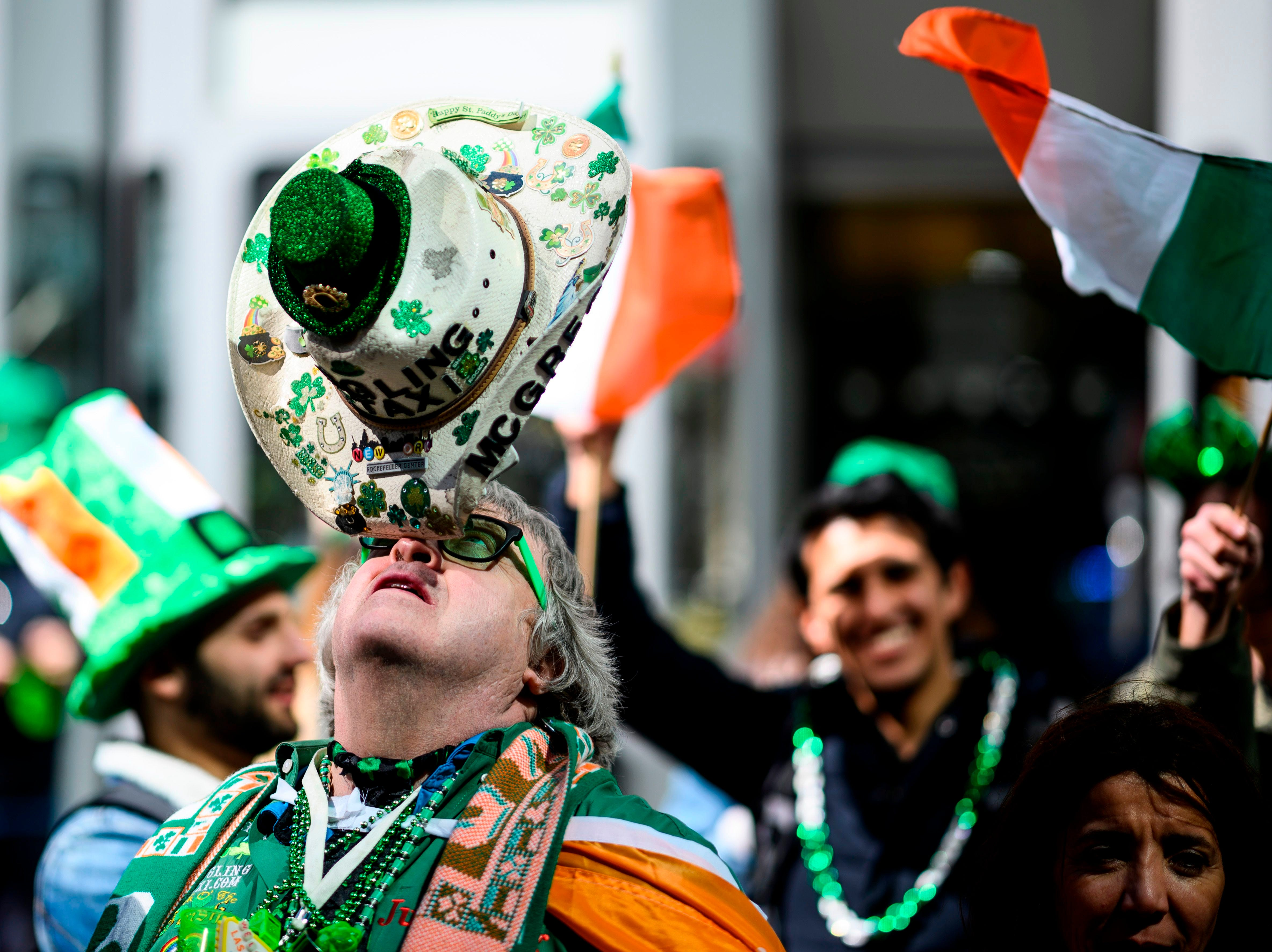 A man balances his hat during the annual New York City St. Patrick's Day Parade on March 16, 2019. The New York City St. Patrick's Day parade, dating back to 1762, is the world's largest St. Patrick's Day celebration.