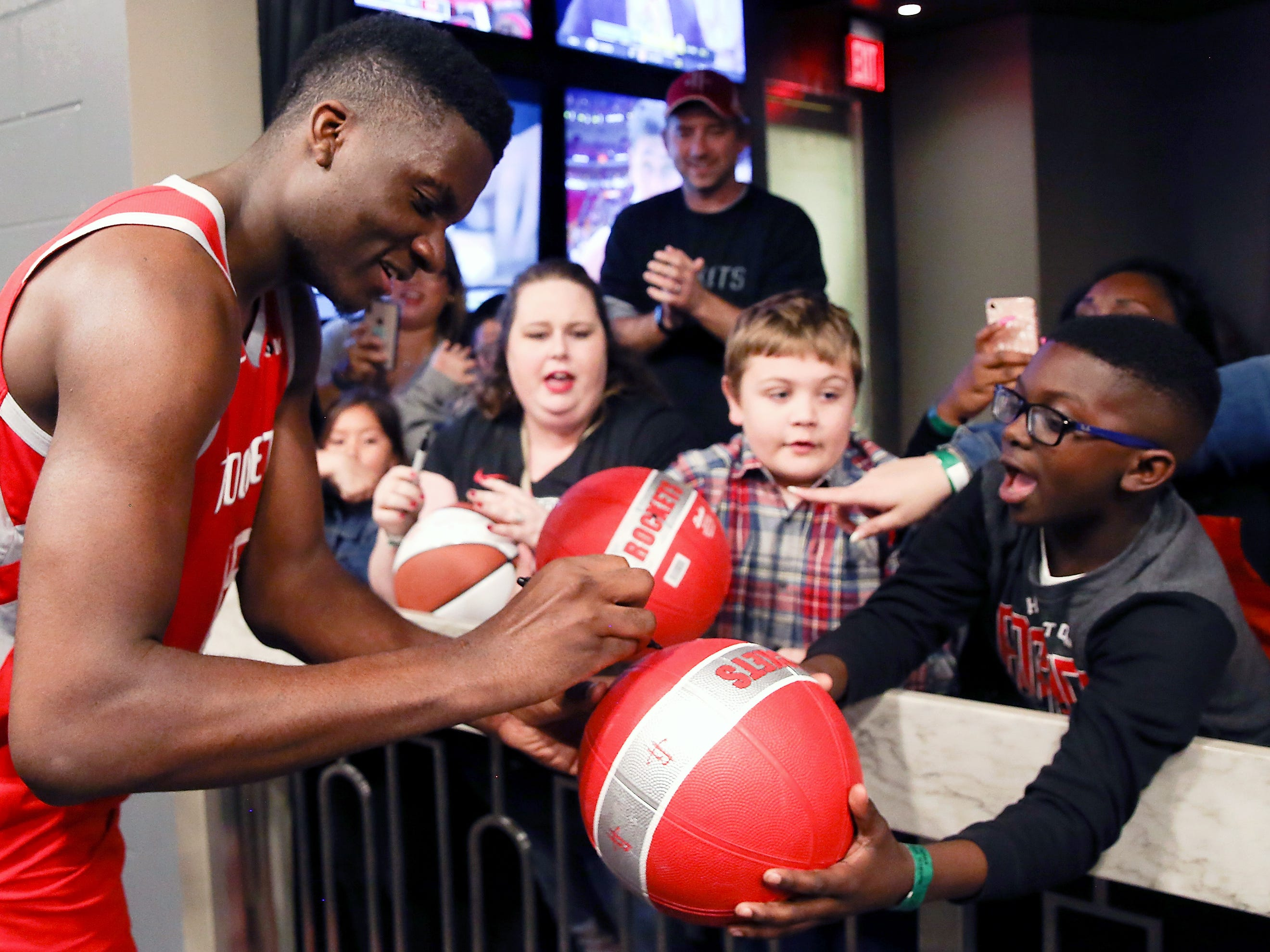 March 15: Rockets center Clint Capela stops to sign some autographs after defeating the Suns at Toyota Center. in Houston.