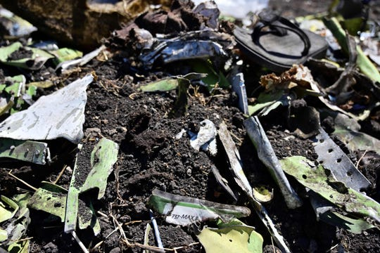 Debris including a charred part of an onboard safety instruction card are is seen at the crash site of an Ethiopian airways operated Boeing 737 MAX aircraft on March 16, 2019 at Hama Quntushele village near Bishoftu in Oromia region. A French investigation into the March 10 Nairobi-bound Ethiopian Airlines Boeing 737 MAX crash that killed 157 passengers and crew opened on March 15 as US aerospace giant Boeing stopped delivering the top-selling aircraft.