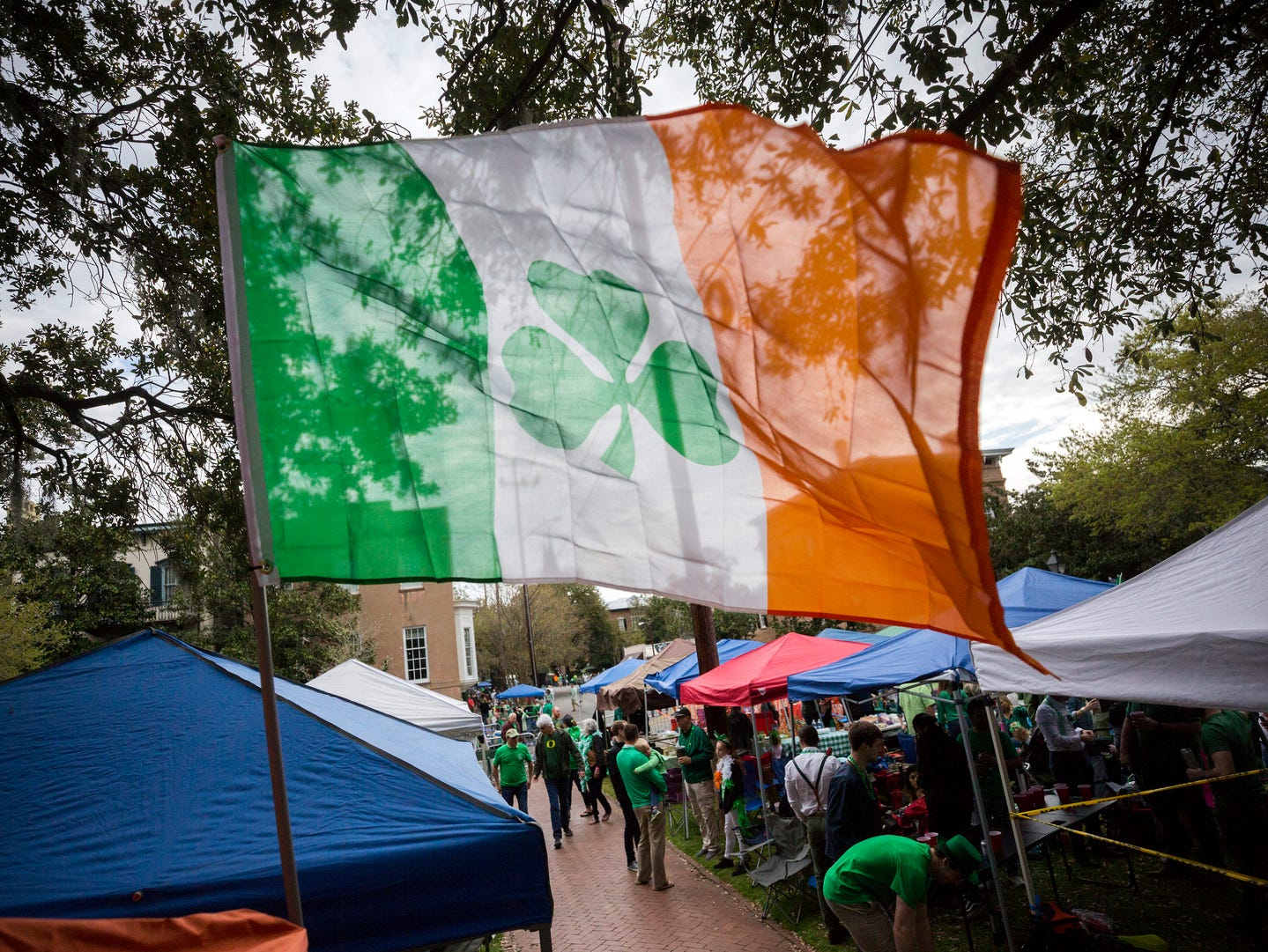 Revelers prepare for the 195-year-old St. Patrick's Day parade on one of the city's historic squares, Saturday, March 16, 2019, in Savannah, Ga.