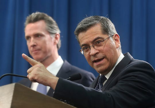 California Attorney General Xavier Becerra, right, accompanied by Gov. Gavin Newsom, leads a group of 20 state attorneys general suing President Trump over his border wall emergency declaration.