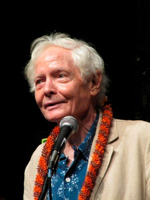 In this Aug. 2, 2011 file photo, poet W.S. Merwin speaks to the Hawaii Conservation Conference in Honolulu.