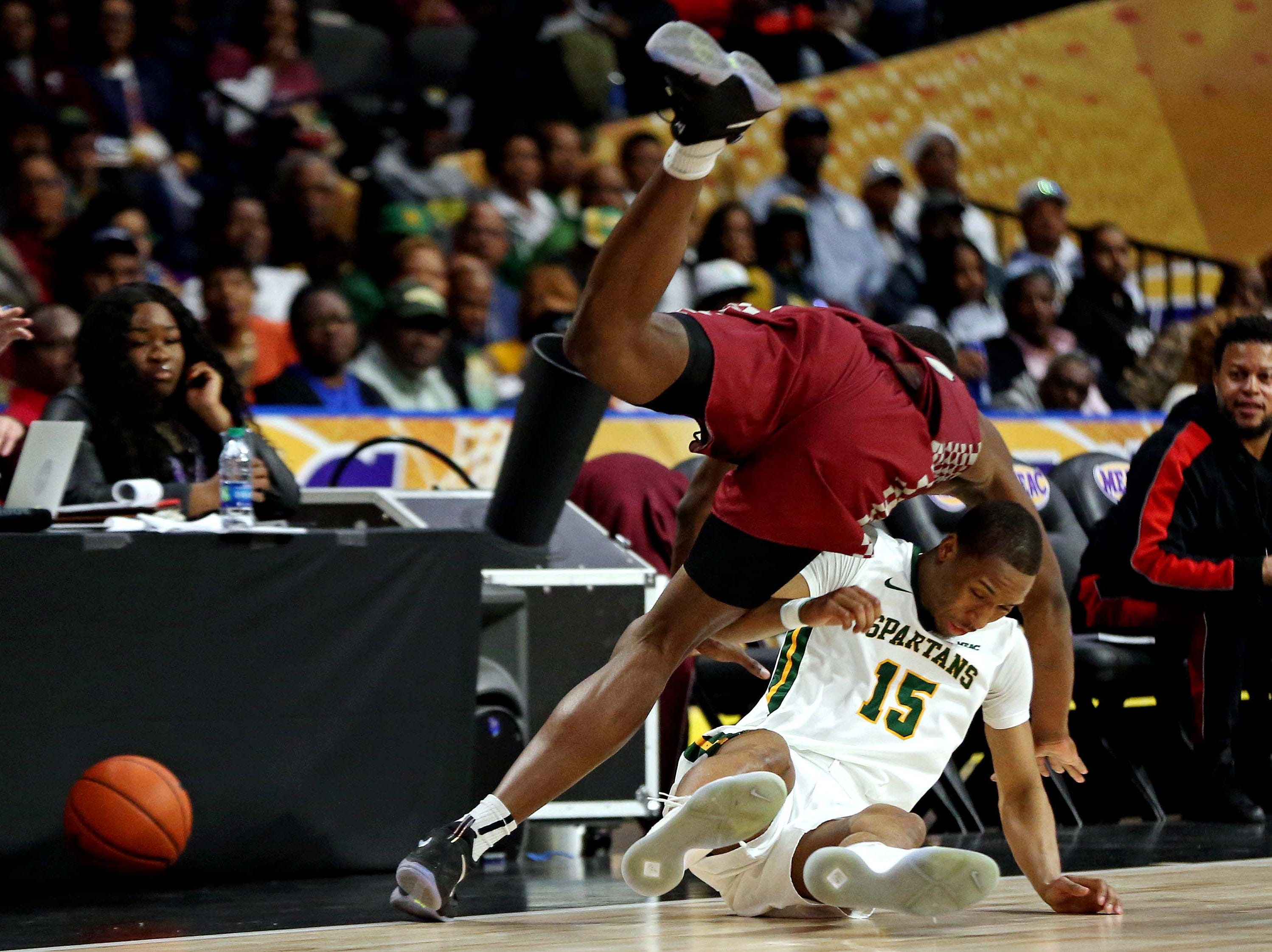 March 16: North Carolina Central Eagles center Raasean Davis (32) and Norfolk State Spartans guard C.J. Kelly (15) go for a loose ball during the second half in the MEAC tournament final.