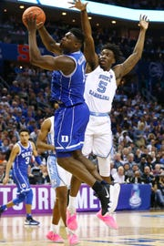 Duke Blue Devils forward Zion Williamson (1) shoots against North Carolina Tar Heels forward Nassir Little (5) in the second half.