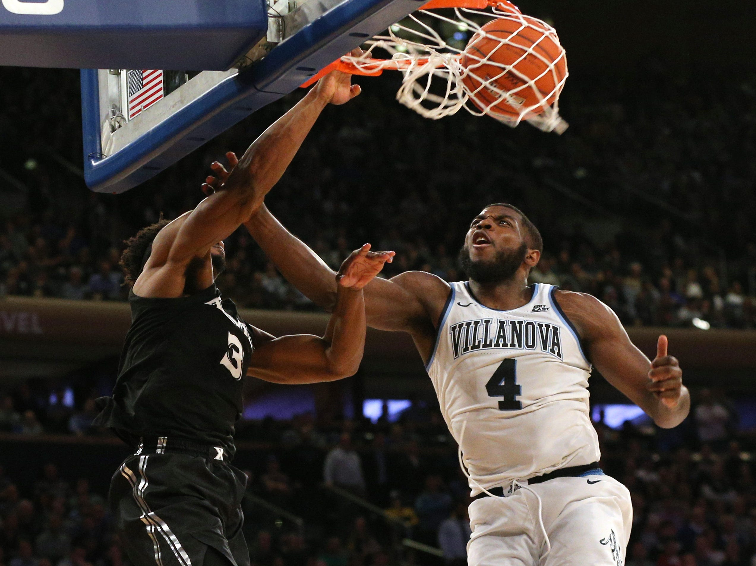 March 15: Xavier Musketeers guard Quentin Goodin (3) dunks against Villanova Wildcats forward Eric Paschall (4) during overtime of a Big East tournament game.