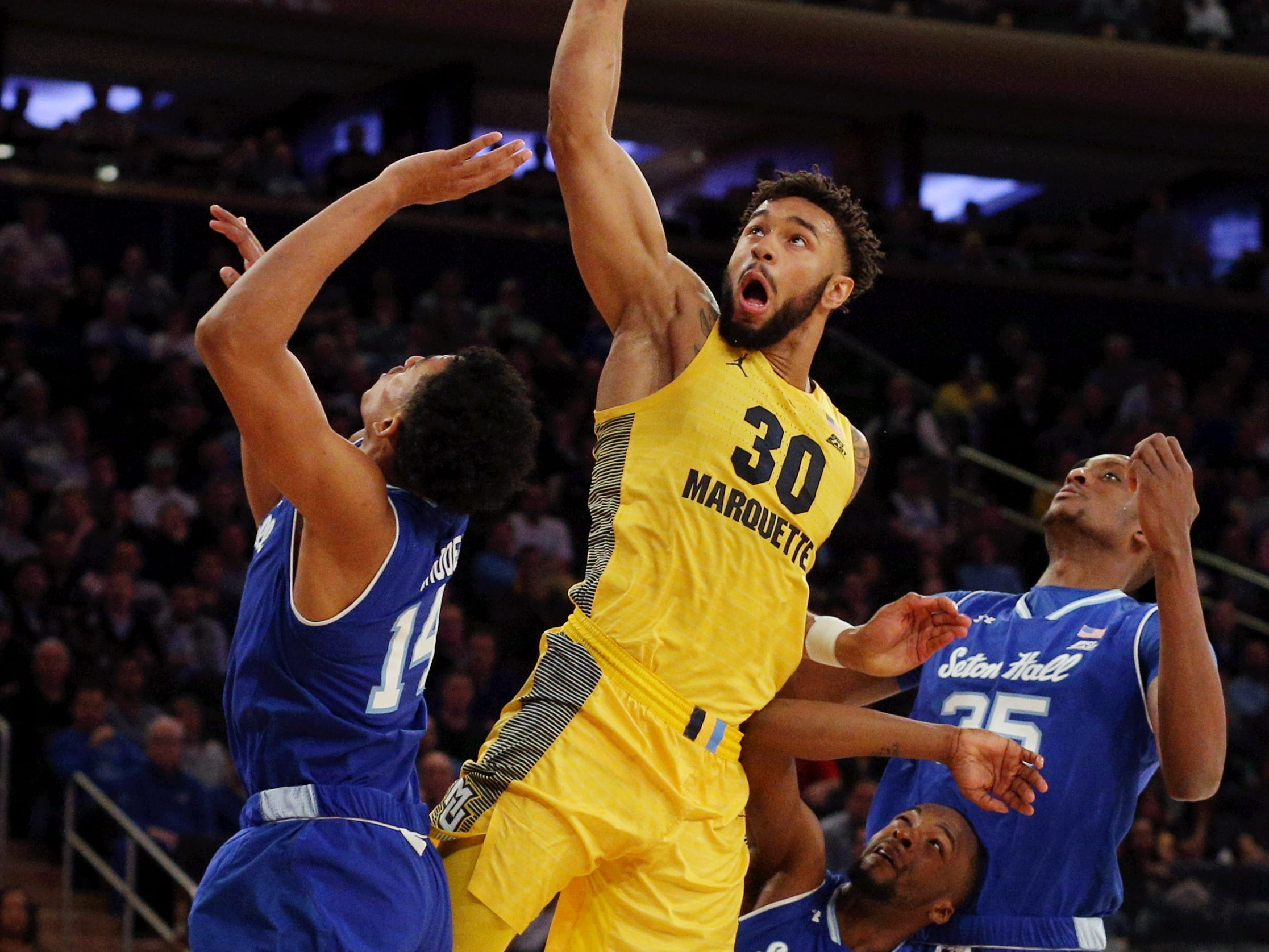 March 15: Marquette Golden Eagles forward Ed Morrow (30) dunks an offensive rebound against Seton Hall during the first half of a Big East tournament game.