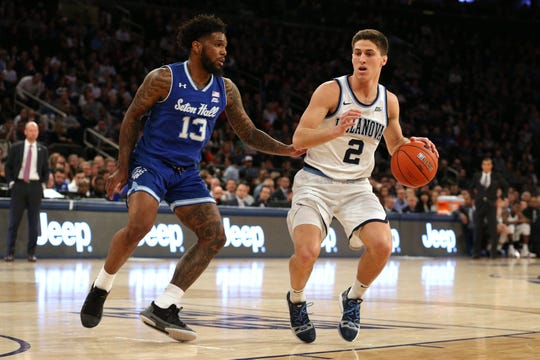 Villanova Wildcats guard Collin Gillespie (2) controls the ball against Seton Hall Pirates guard Myles Powell (13) during the first half of the Big East conference tournament final at Madison Square Garden.