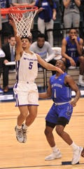 ACU's Payten Ricks, left, drives to the basket as New Orleans' Damion Rosser looks on. ACU beat the Privateers 77-60 to win the Southland Conference Tournament title March 16 at the Merrell Center in Katy. Ricks is one of seven returning players to this season's team, and he is the only returning starter.