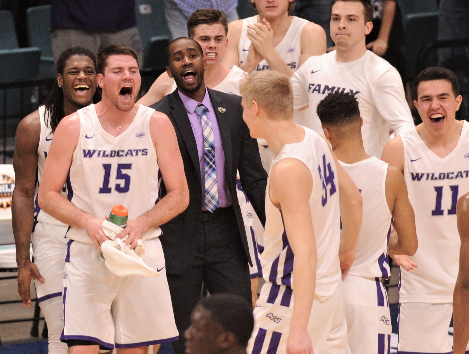 ACU's Hayden Farquhar (15) and the rest of his teammates greet players as they come to the bench during a timeout against New Orleans. ACU beat the Privateers 77-60 to win the Southland Conference Tournament title Saturday, March 16, 2019, at the Merrell Center in Katy.
