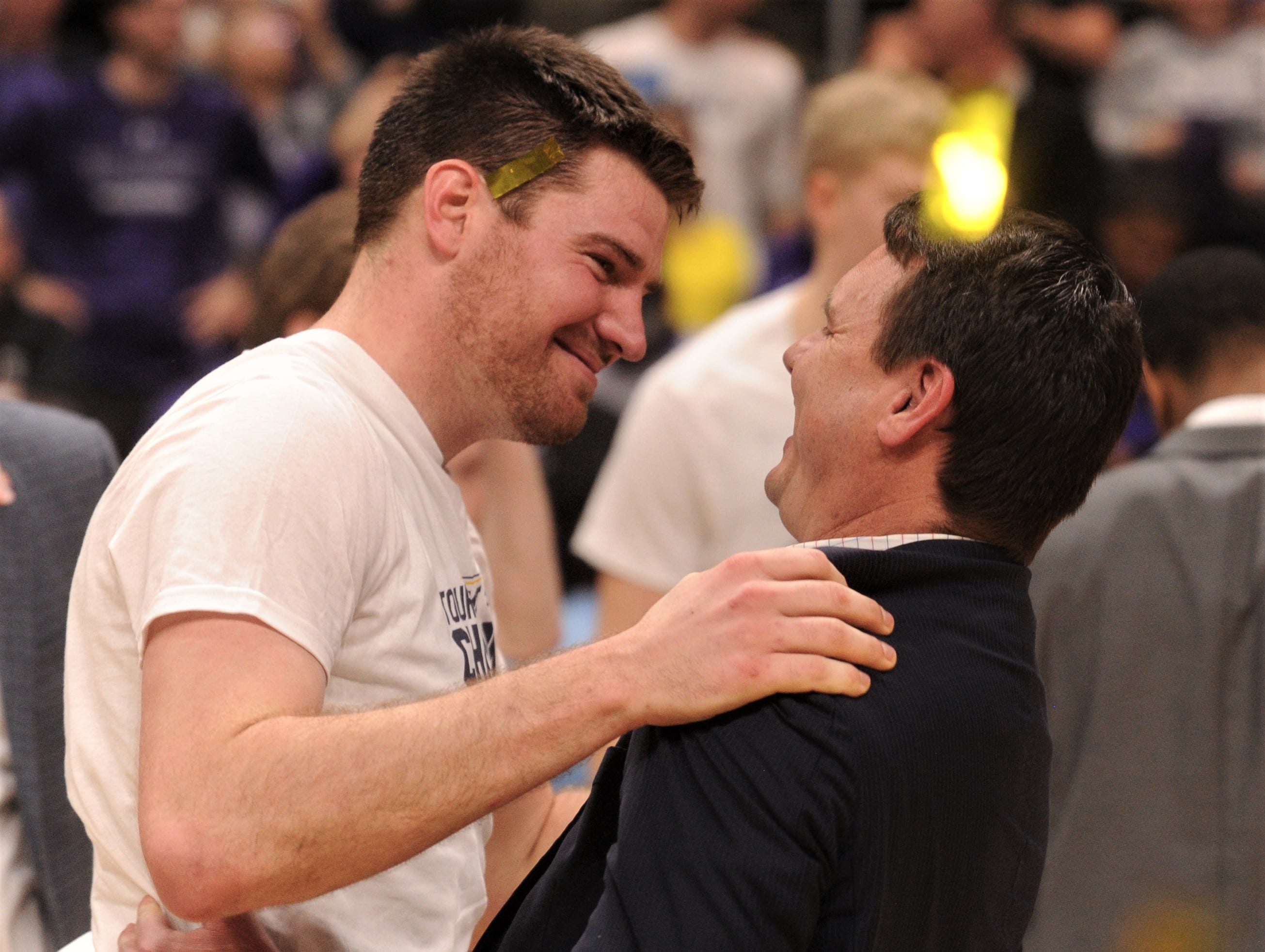 ACU coach Joe Golding, right, celebrates with senior Hayden Farquhar after the Wildcats beat New Orleans 77-60 in the Southland Conference Tournament championship game Saturday, March 16, 2019, at the Merrell Center in Katy.