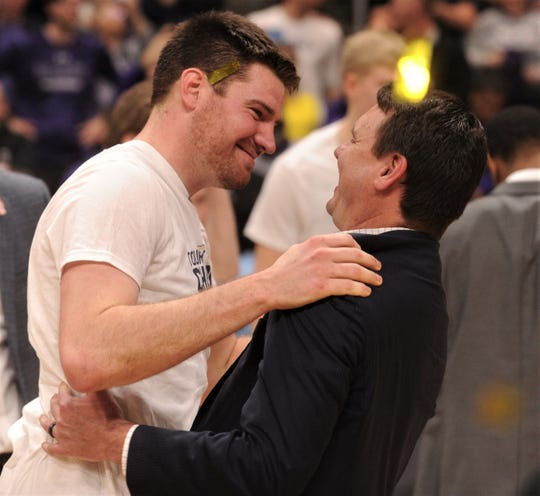 ACU coach Joe Golding, right, celebrates with senior Hayden Farquhar after the Wildcats beat New Orleans 77-60.