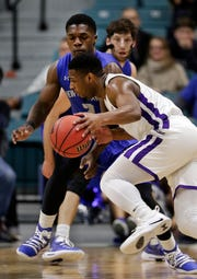 Abilene Christian guard Jaylen Franklin, front, drives around New Orleans guard Troy Green, back, during the first half of an NCAA college basketball game for the Southland Conference men's tournament title Saturday, March 16, 2019, in Katy, Texas.