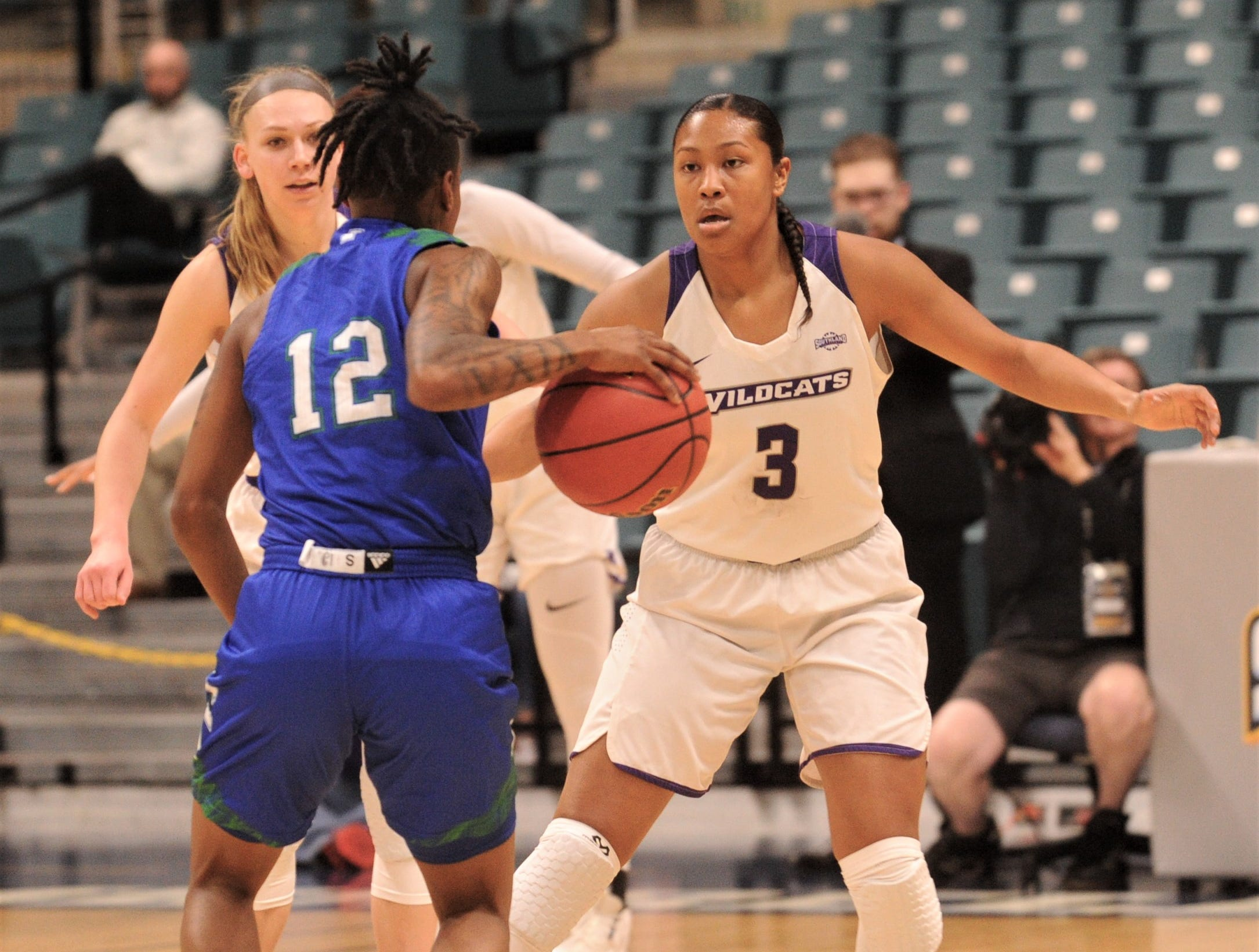 ACU's Dominique Golightly (3) defends against Texas A&M-Corpus Christi's Dae Dae Evans in the first quarter of the Southland Conference Tournament championship game Sunday, March 17, 2019, at the Merrell Center in Katy.