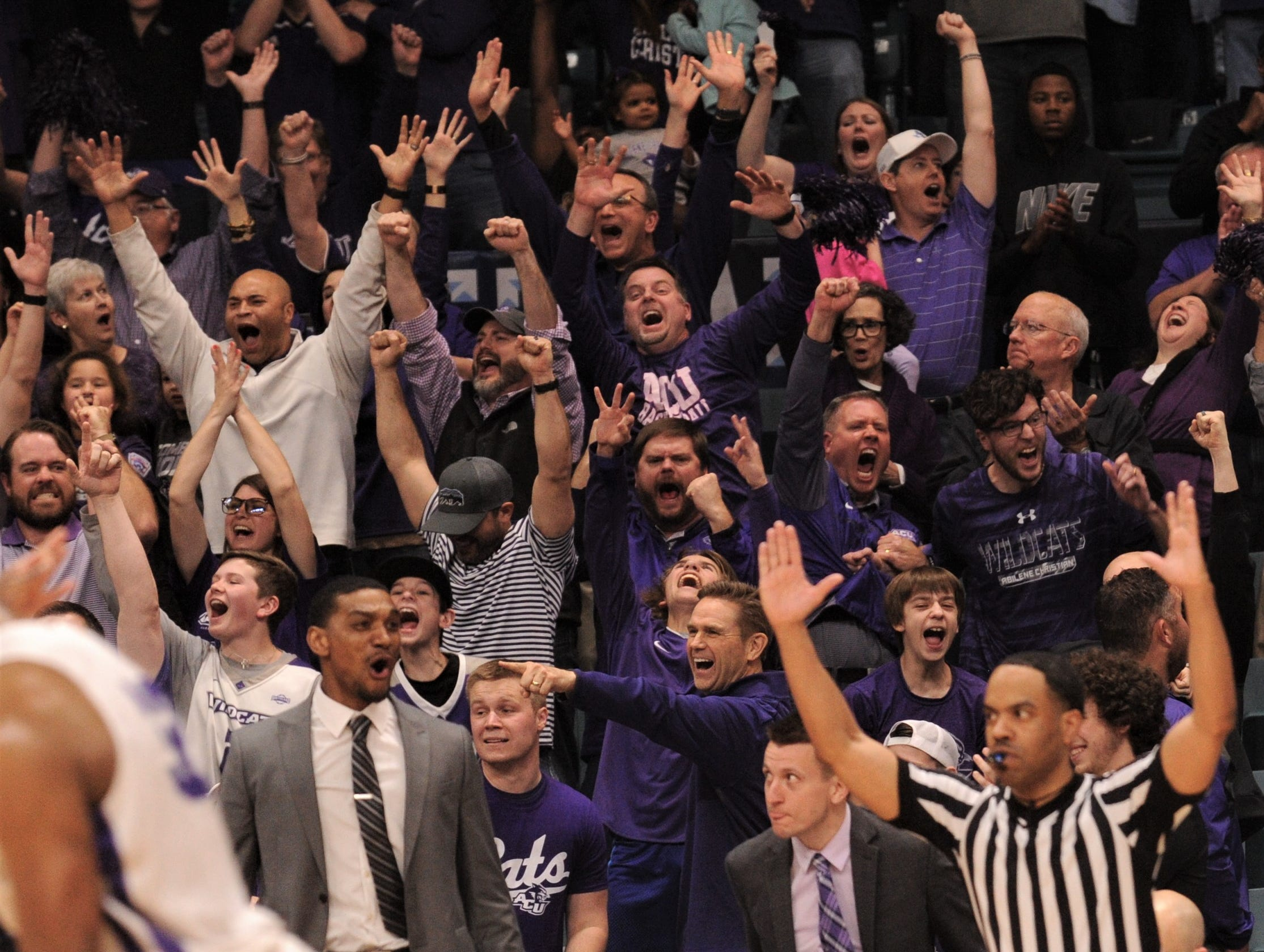 ACU fans celebrate after the Wildcats hit a 3-point play in the second half against New Orleans. ACU beat the Privateers 77-60 to win the Southland Conference Tournament title Saturday, March 16, 2019, at the Merrell Center in Katy.