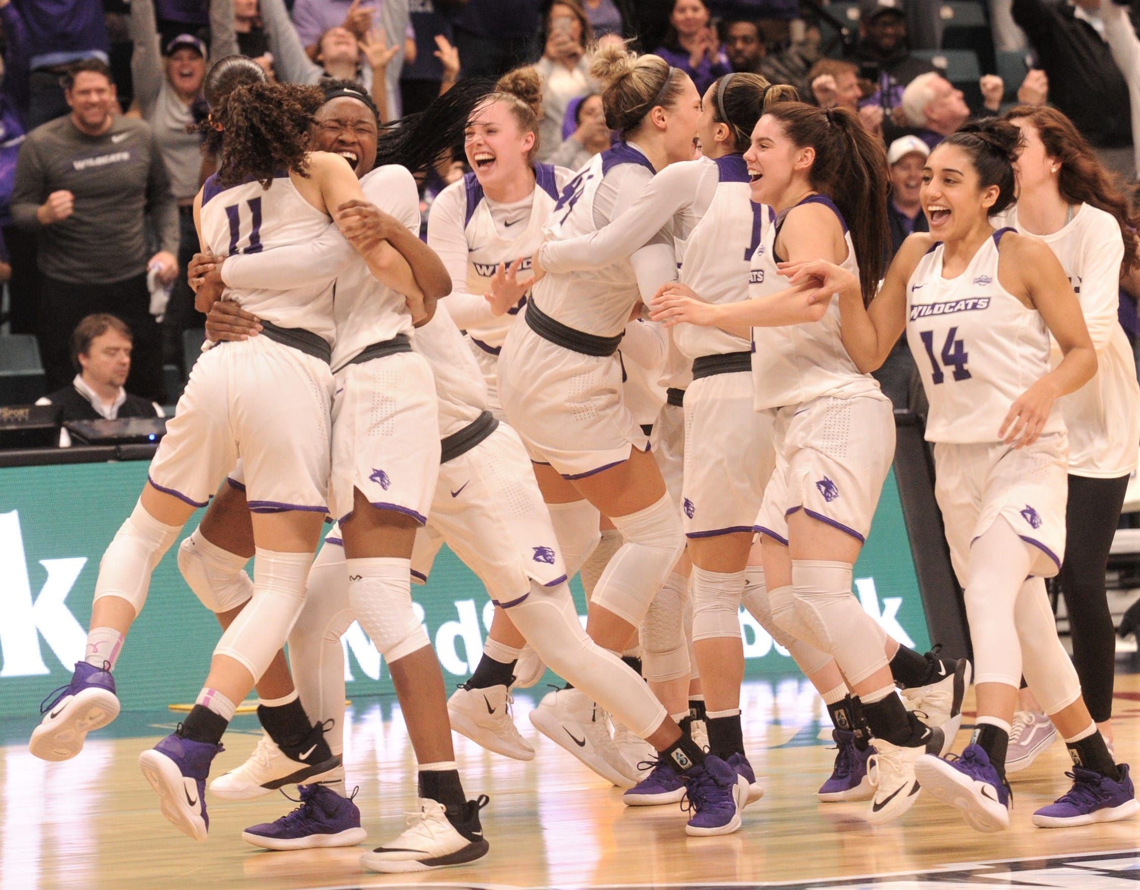 ACU women basketball players celebrate after beating Texas A&M-Corpus Christi 69-68 for the Southland Conference Tournament title March 17 at the Merrell Center in Katy.