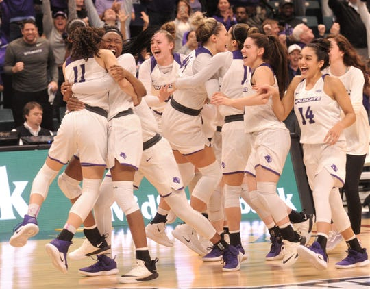 ACU players celebrate after beating Texas A&M-Corpus Christi 69-68 for the Southland Conference Tournament title March 17 at the Merrell Center in Katy.