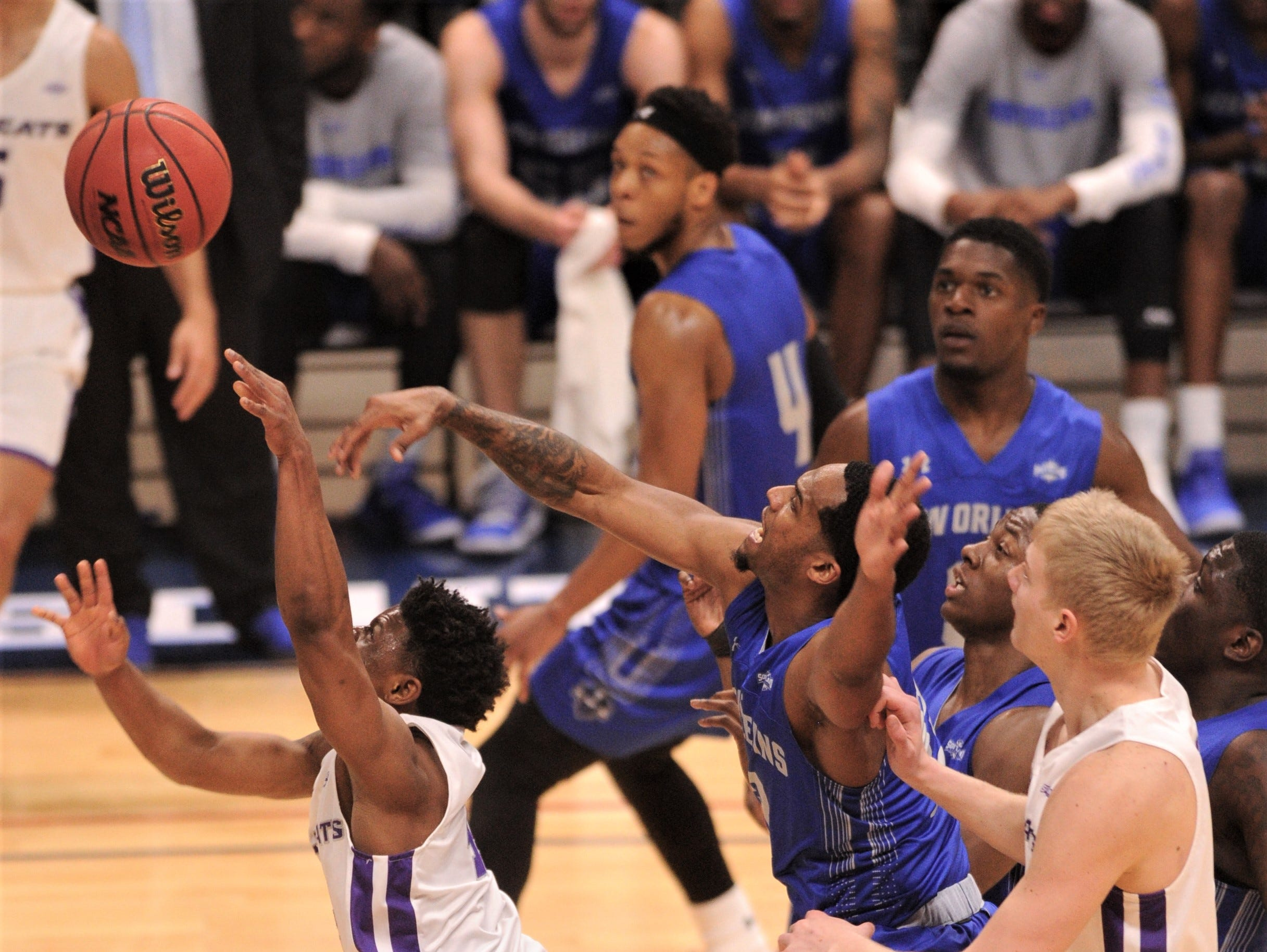 ACU's Damien Daniels, left, drives to the basket against the New Orleans defense. ACU beat the Privateers 77-60 to win the Southland Conference Tournament title Saturday, March 16, 2019, at the Merrell Center in Katy.