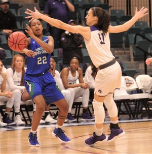 Texas A&M-Corpus Christi's Dalesia Booth, left, passes the ball while ACU's Sara Williamson defends during the first quarter of the Southland Conference Tournament championship game Sunday, March 17, 2019, at the Merrell Center in Katy.