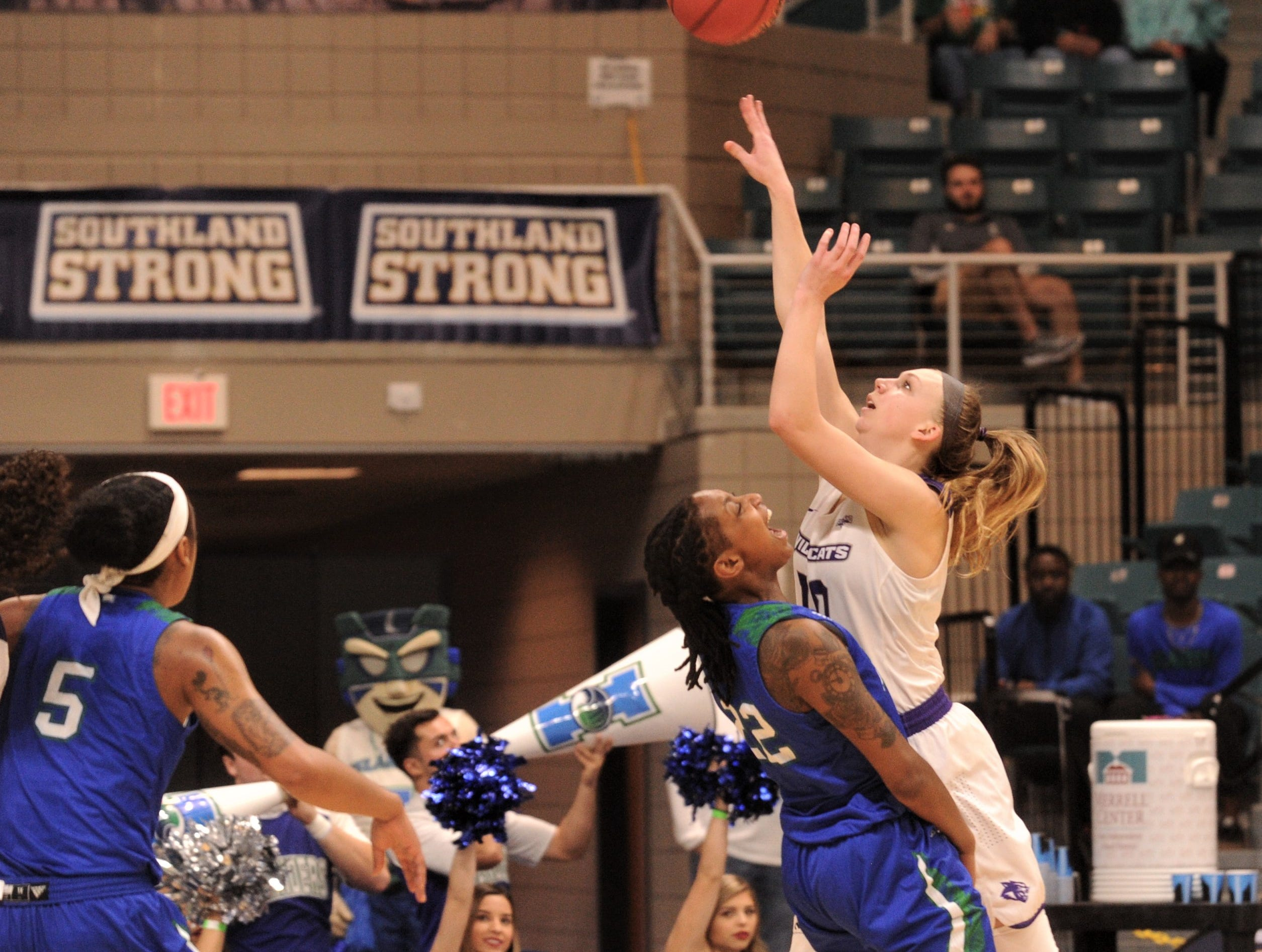 ACU's Breanna Wright, right, shoots over Texas A&M-Corpus Christi's Dalesia Booth in the first quarter of the Southland Conference Tournament championship game Sunday, March 17, 2019, at the Merrell Center in Katy.