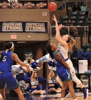 ACU's Breanna Wright, right, shoots over Texas A&M-Corpus Christi's Dalesia Booth in the first quarter of the Southland Conference Tournament championship game Sunday at the Merrell Center in Katy.