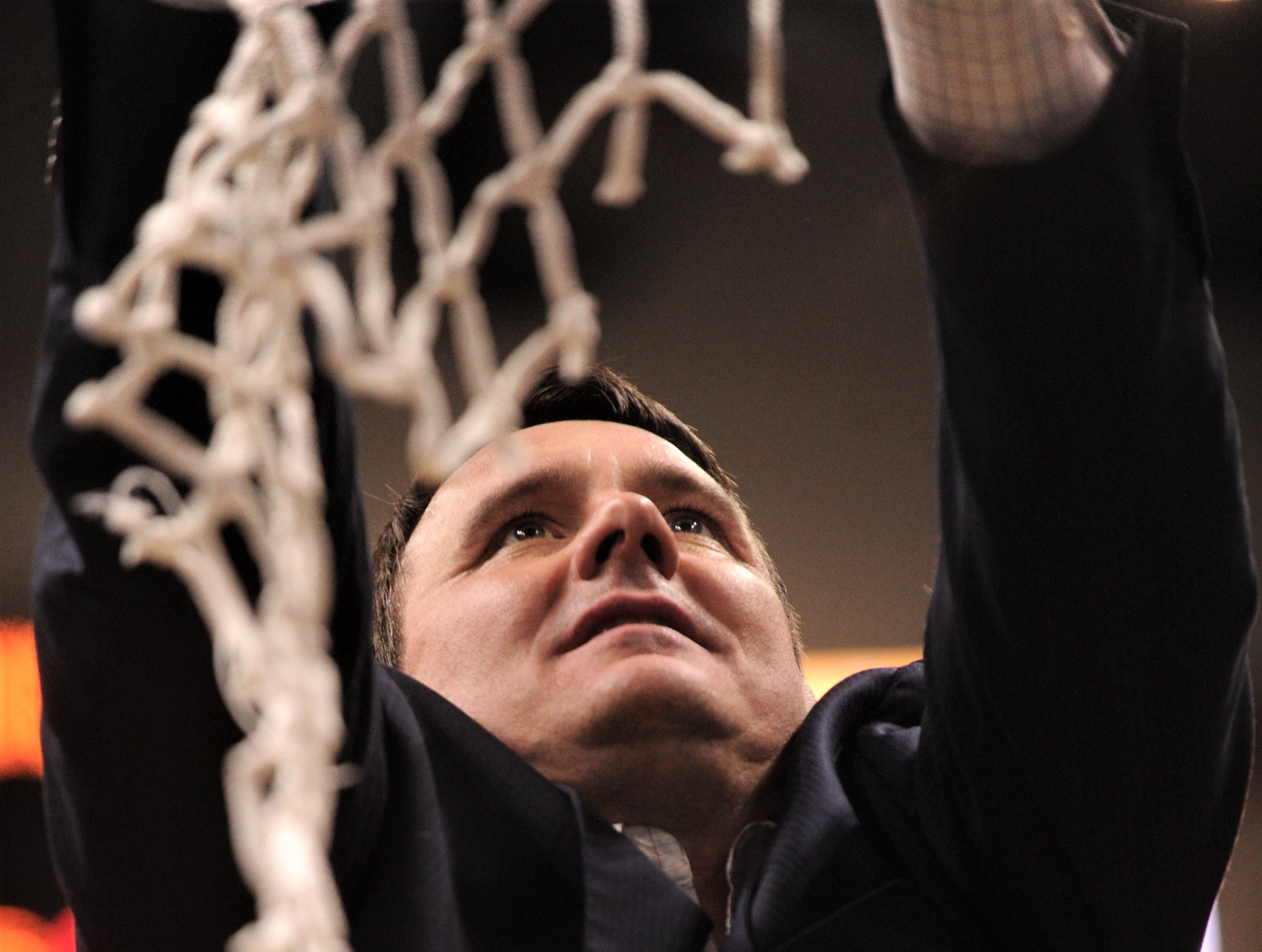 ACU coach Joe Golding cuts a piece of the net after his Wildcats won the Southland Conference Tournament title on Saturday, March 16, 2019, at the Merrell Center in Katy.