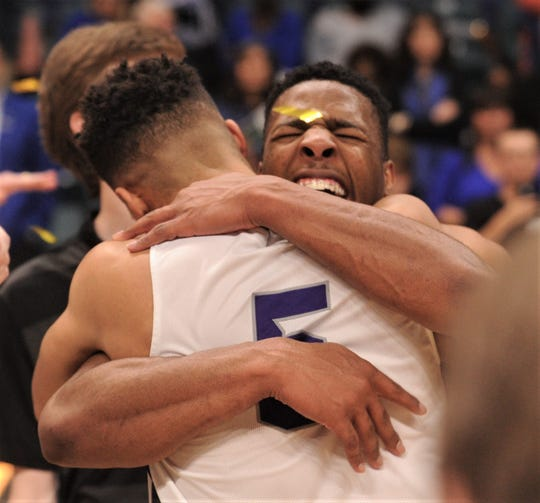 ACU senior Jaylen Franklin, rear, hugs teammate Payten Ricks after the Wildcats beat New Orleans 77-60 in the Southland Conference Tournament championship game on Saturday, March 16, 2019, at the Merrell Center in Katy.