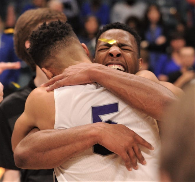 ACU senior Jaylen Franklin, rear, hugs teammate Payten Ricks after the Wildcats beat New Orleans 77-60 in the Southland Conference Tournament championship game last season at the Merrell Center in Katy.