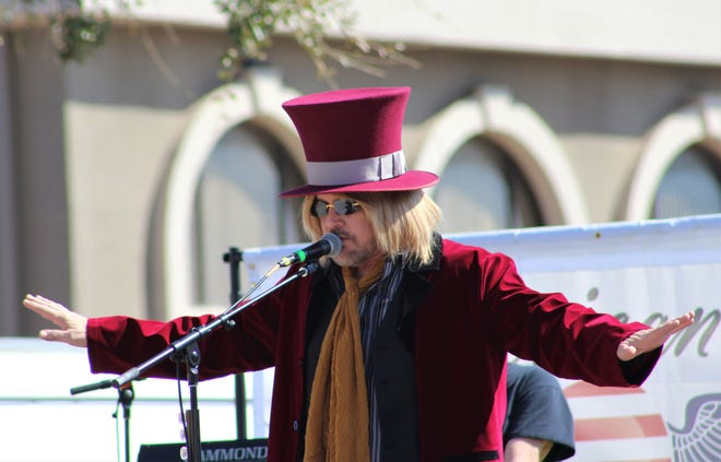 Whiskey Diamond, lead singer of the Tom Petty tribute band American Petty donned the late singer's famous top hat and coat during the Dallas band's show Saturday at Kent's Harley-Davidson.