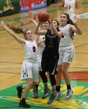 Watkins Glen's Hannah Morse (3) goes up for a shot while surrounded by Cambridge defenders  during the class C championship at Hudson Valley Community College in Troy March 15, 2019. Cambridge won the game 57-43.