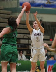 Mendon's Katie Bischoping (31) puts up a shot in front of Seton Catholic's Marina Maerkl (24) during the girls Class A state championship game at Hudson Valley Community College in Troy March 17, 2019.